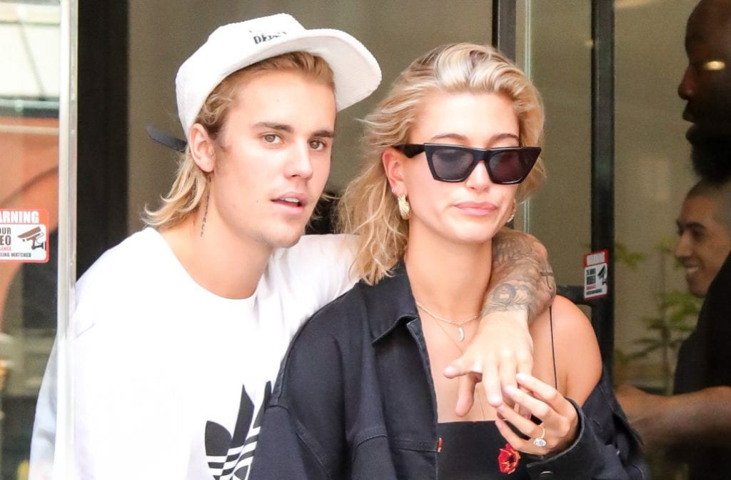 Why did Justin Bieber and Hailey Baldwin postpone their wedding?